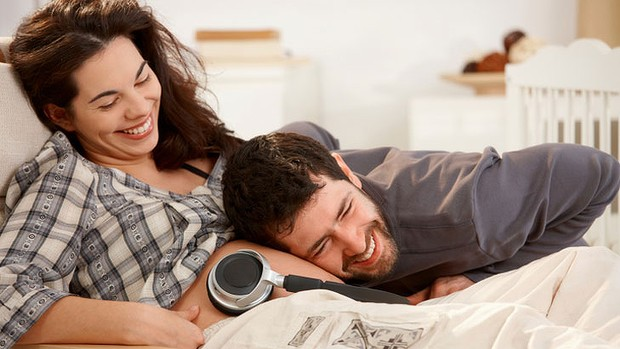 pregnant woman with husband listening to music